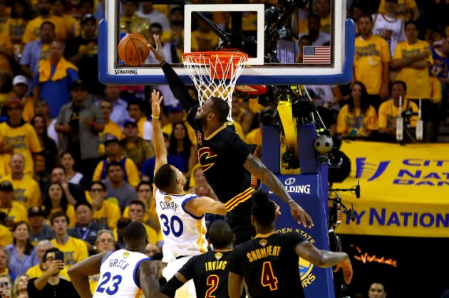 OAKLAND, CA - JUNE 19:  LeBron James #23 of the Cleveland Cavaliers blocks a shot by Stephen Curry #30 of the Golden State Warriors in Game 7 of the 2016 NBA Finals at ORACLE Arena on June 19, 2016 in Oakland, California. NOTE TO USER: User expressly acknowledges and agrees that, by downloading and or using this photograph, User is consenting to the terms and conditions of the Getty Images License Agreement.  (Photo by Ezra Shaw/Getty Images)